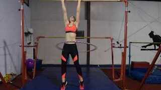 Woman Attempts World Record For Most Chin-ups While Hula Hooping - Video