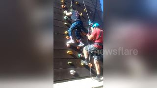 Woman with spastic cerebral palsy conquers climbing wall - Video