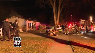 Crews respond to house fire in Lansing - Video