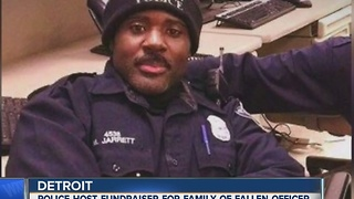 Police hold fundraiser for fallen officer's family - Video