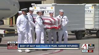 Casket carrying body of Navy fireman killed in Pearl Harbor arrives at KCI - Video