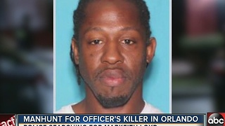 Manhunt for officer's killer in Orlando - Video