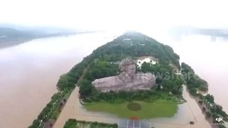 Aerial footage of famous Chinese tourist attraction completely flooded - Video