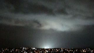 Flashes From Transformer Fire Arc in Night Sky Over Recife - Video