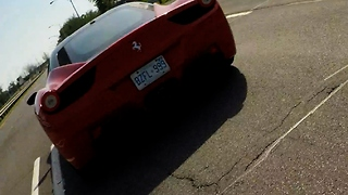 GoPro falls off moving Ferrari on busy highway