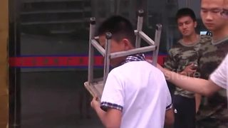 Boy gets head stuck between stool legs in southeastern China - Video