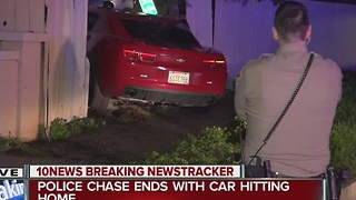Police chase ends with car driving into a home - Video