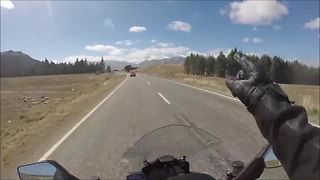 Motorcyclist avoids extremely close call on New Zealand highway - Video