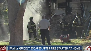 Family escapes after fire started at home - Video