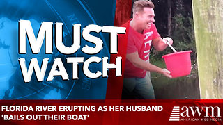Florida river erupting as her husband 'bails out their boat' - Video