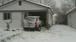Jeep crashes into home - Video