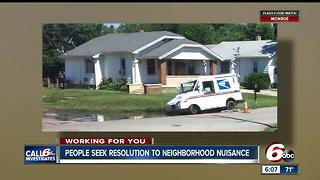 Mail truck gets stuck in sinkhole on Indy's southwest side - Video