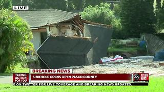 Sinkhole forms, continues to grow at Land O' Lakes home, surrounding homes evacuated - Video