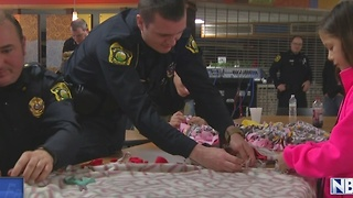 Officers make blankets for the community during the holidays