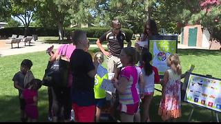 Children eat for free at Picnic in the Park - Video