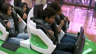 Siblings separated by foster care reunited at Adventuredome - Video