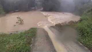 Flooding Swells River on Koh Samui, Thailand - Video