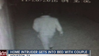 Home intruder gets into bed with couple - Video