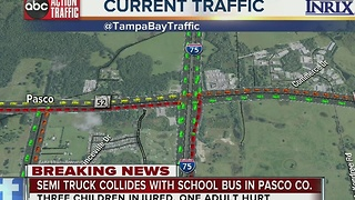 Semi truck collides with school bus in Pasco County - Video
