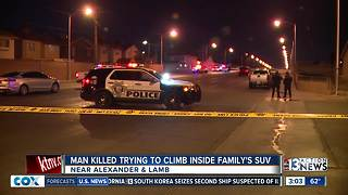 Man killed after trying to climb inside SUV - Video