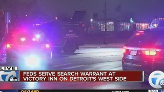 Federal agents conducting search warrant at Detroit motel - Video
