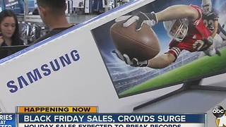Black Friday sales, crowds surge