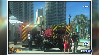 Teen dies after being pulled from water at beach - Video