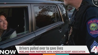 Roeland Park police officers hand out CPR Kits