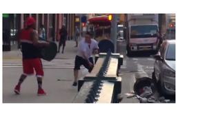 Man with Machete Battles Man with Trash Can on NY Street - Video