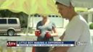 Little boy holds lemonade stand for domestic violence shelter - Video