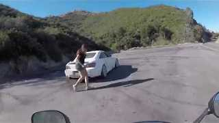Extremely Close Call For Motorcyclist As On-Coming Car Spins Out of Control - Video