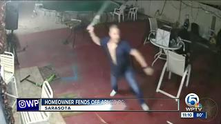 Florida homeowner uses machete to fight off armed robbers - Video
