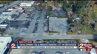Re-zoning of a parking lot on Brookside could leave around 30 less parking spaces