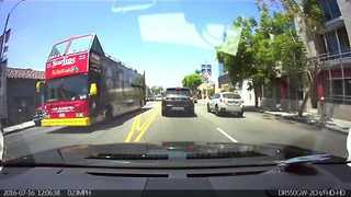 Man Stops Traffic to Help Women Cross Busy Melrose Avenue - Video