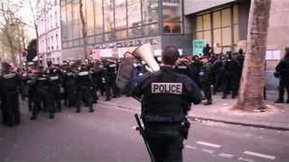 Police Attempt to Remove Migrants Occupying School Building in Paris - Video