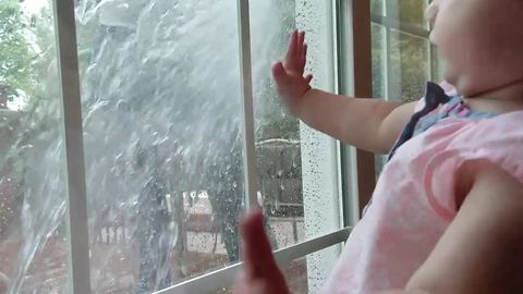 Tot Girl Gets Startled When Her Dad Sprays Window She Stares Out