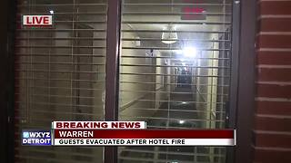 About 100 evacuated after fire at Warren hotel - Video