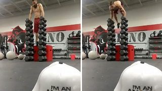 Former marine dubbed 'the balance guru' pulls off another impressive stunt – performing handstand push ups on a huge tower of dumbbells