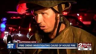 Investigators search for cause of house fire - Video