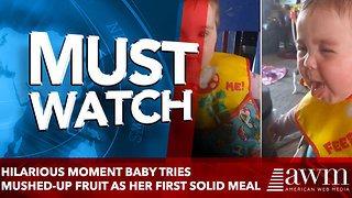 Hilarious moment baby tries mushed-up fruit as her first solid meal - Video