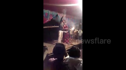 Man fires gun point-blank at Indian wedding dancer, narrowly missing her
