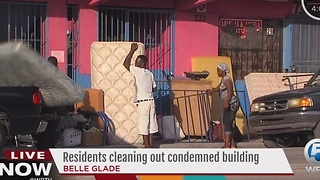Residents cleaning out condemned building in Belle Glade - Video