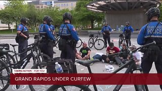Calm night reported as Grand Rapids goes under curfew