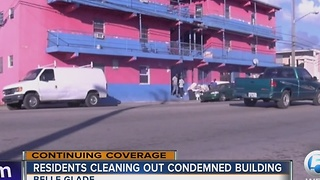 Residents cleaning out condemned building - Video