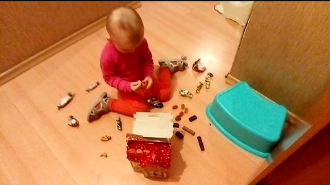 Candy. The little girl opened all the candy from the gift.