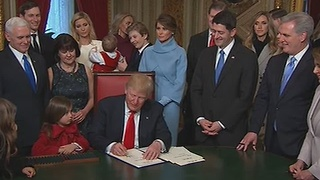 President Trump begins signing in his staff into office - Video