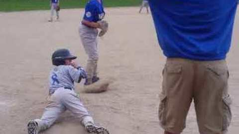 Kid Steals Third Base With Dramatic Jump During Baseball Game