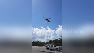 Sandbags airlifted to lake in flooded Carolina city following Hurricane Florence