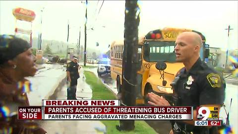 Parents accused of threatening bus driver