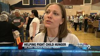 Volunteers pack more than 20,000 meals to fight child hunger - Video
